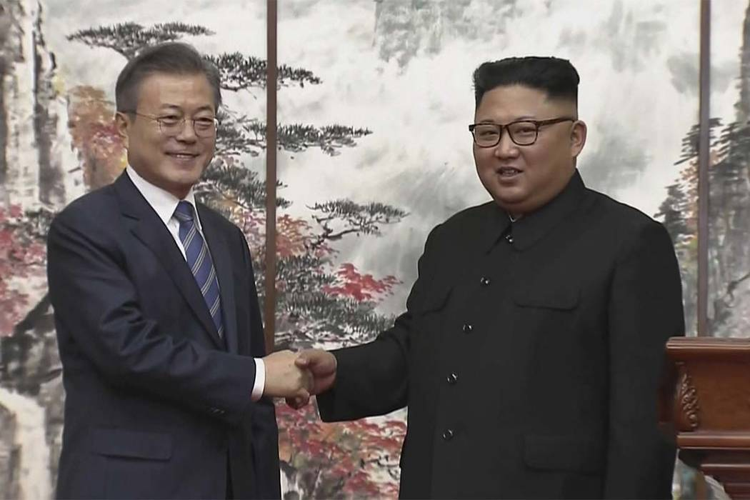 In this image made from video, North Korean leader Kim Jong Un, right, and South Korean President Moon Jae-in shake hands at the end of their joint news conference in Pyongyang, North Korea Wednes ...
