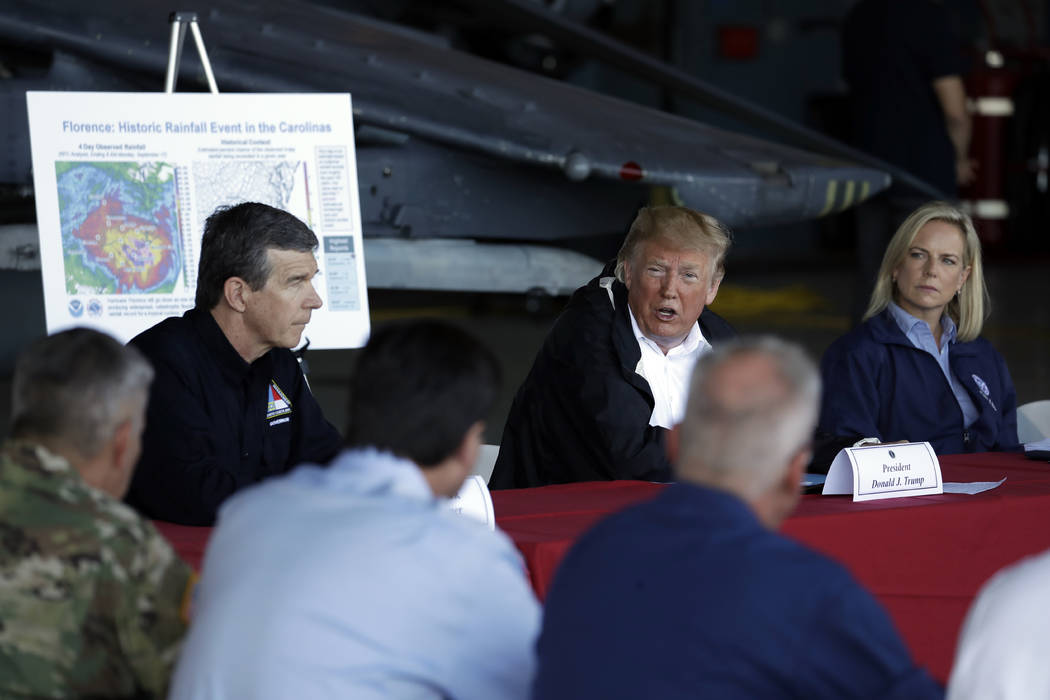 President Donald Trump speaks while attending a briefing, after arriving at Marine Corps Air Station Cherry Point to visit areas impacted by Hurricane Florence, Wednesday, Sept. 19, 2018, in Havel ...