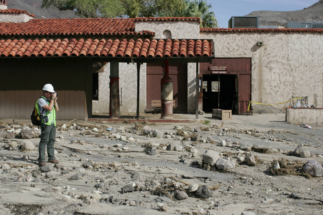 Dan Kish, visitor use assistant, takes photos and video of the flooding damage done to Scotty's Castle in Death Valley National Park on Saturday, Oct. 24, 2015. On Oct. 18, 2.7 inches of rain fell ...