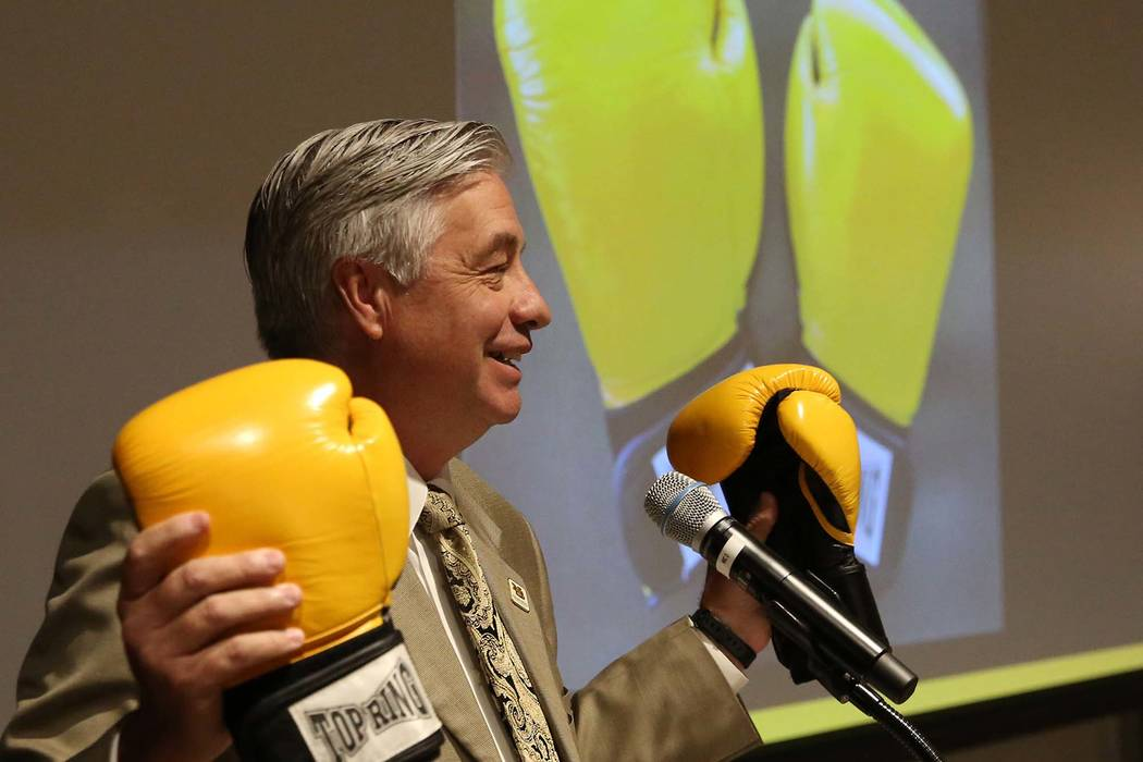 Nevada State College President Bart Patterson holds a pair of boxing gloves as he delivers the State of the College address on Tuesday, Sept. 18, 2018, in Henderson. (Bizuayehu Tesfaye/Las Vegas R ...