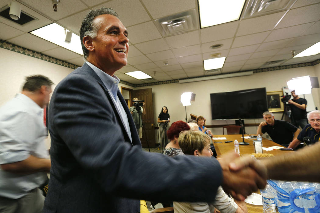 Danny Tarkanian, Republican candidate for the 3rd Congressional District, shakes hands with a panelist as he arrives for the Las Vegas Review-Journal Reader Panel, Wednesday, Aug. 15, 2018. (Chito ...