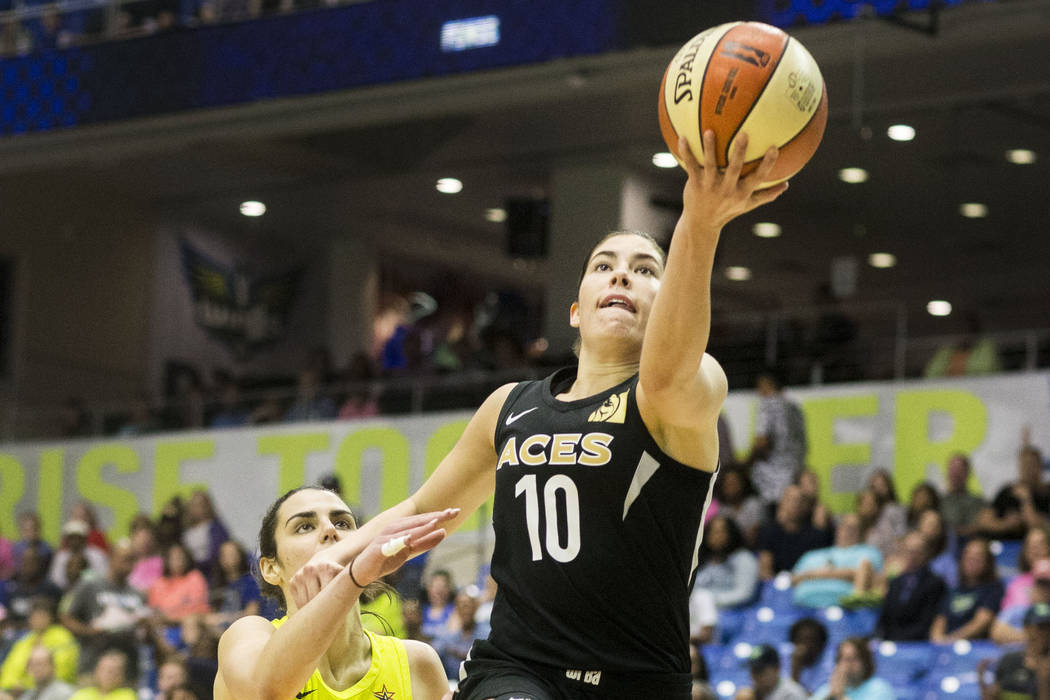 Las Vegas Aces guard Kelsey Plum (10) jumps up to shoot a basket while Dallas Wings guard Leticia Romero (10) attempts to block at College Park Center in Arlington, Texas on Aug. 17, 2018. The Win ...