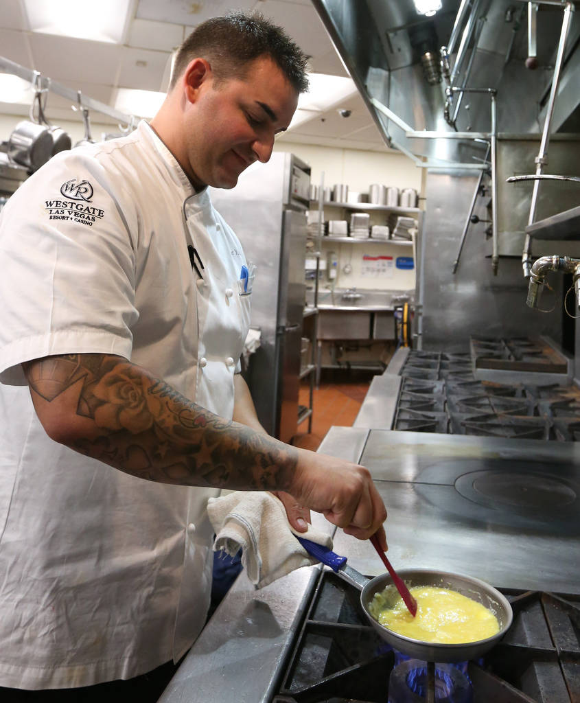 Chef Steve Young stirs the eggs as he makes soft scrambled eggs at Edge Steakhouse on Thursday, Sept. 20, 2018, in Las Vegas. Young used butter, milk, sea salt and chive to make creamy, soft scram ...