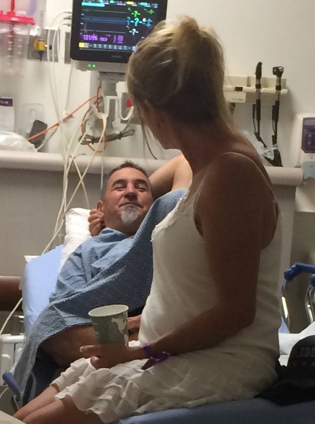 Tami LeBrun, 53, gazes lovingly at her husband, Brian LeBrun, 54, shortly after he was shot in the right arm at the Oct. 1, 2017 mass shooting on the Las Vegas Strip.