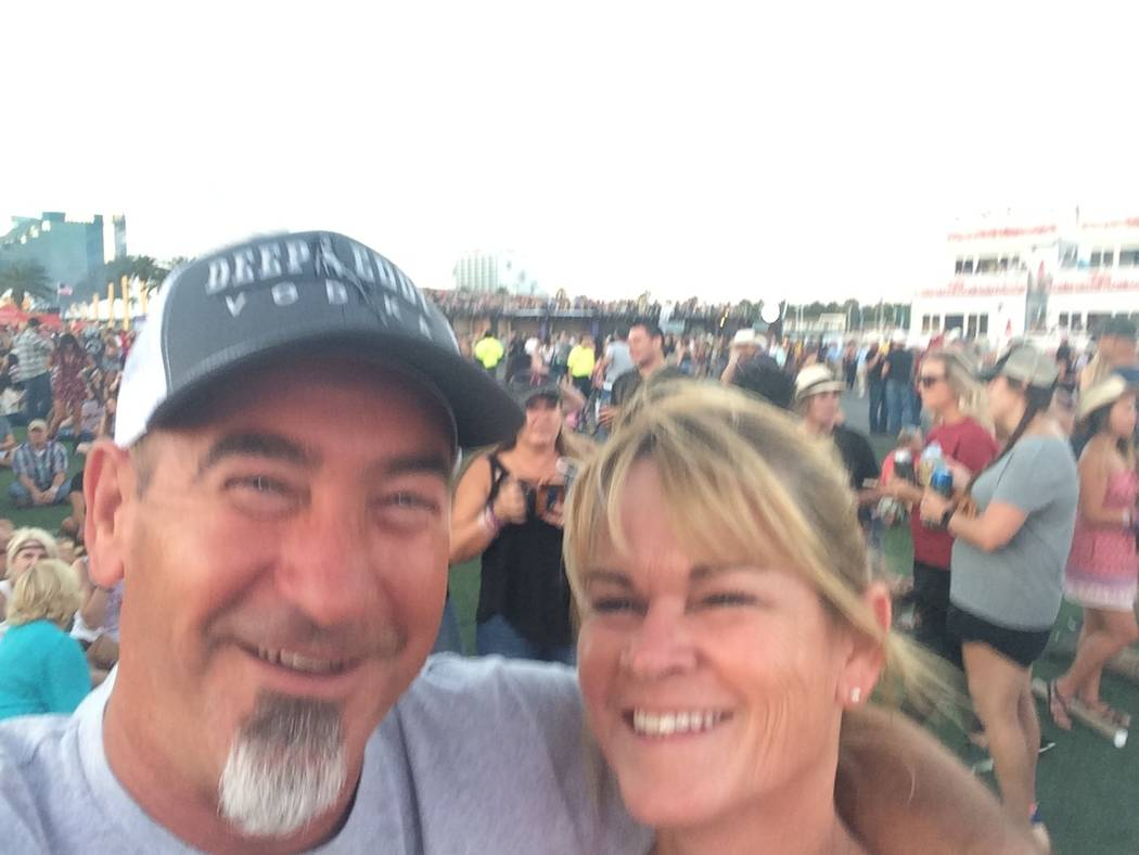 Tami LeBrun, 53, with her husband, Brian LeBrun, 54, shortly at the Route 91 Harvest festival before the Oct. 1, 2017 shooting. (Courtesy of Tami LeBrun)