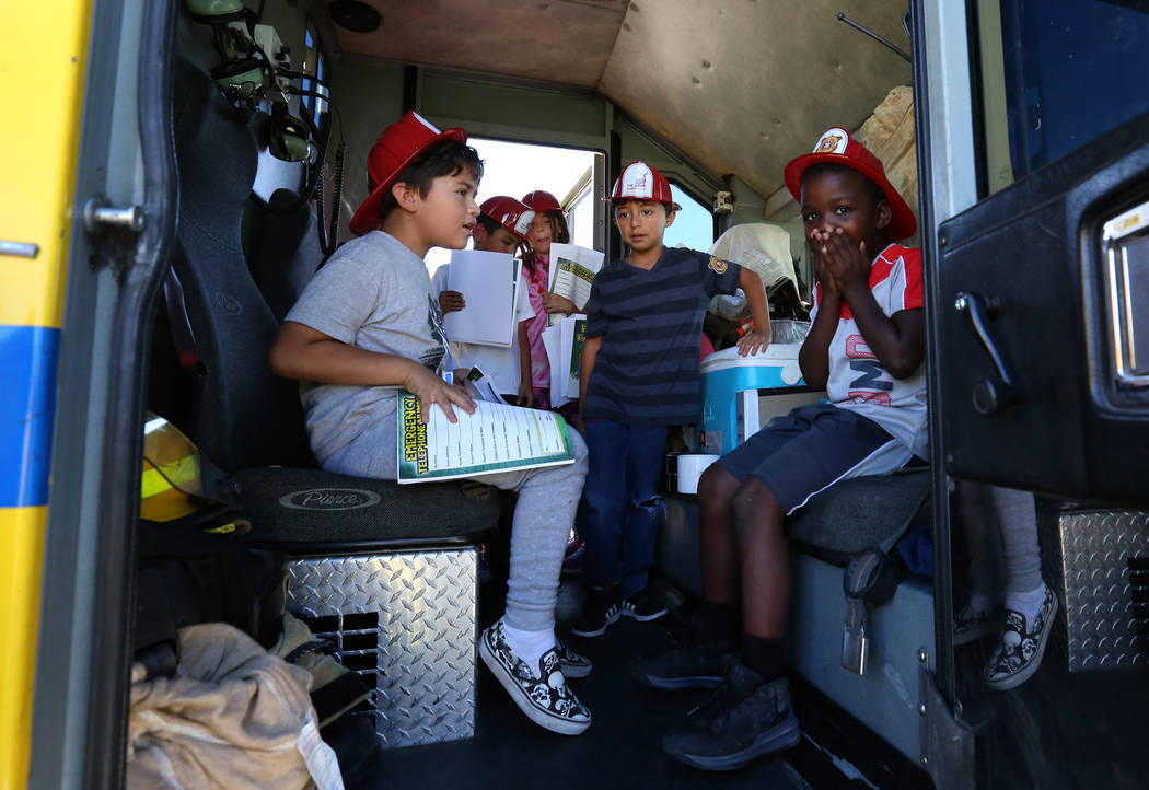 Second grade students check out a fire truck during a fire prevention and safety event at Ann T Lynch Elementary School on Thursday, Sept. 20, 2018, in Las Vegas. (Bizuayehu Tesfaye/Las Vegas Revi ...