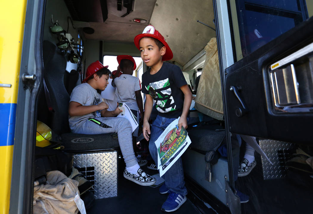 Second grade students, incuding Luis Melendez, check out a fire truck during a fire prevention and safety event at Ann T Lynch Elementary School on Thursday, Sept. 20, 2018, in Las Vegas. (Bizuaye ...