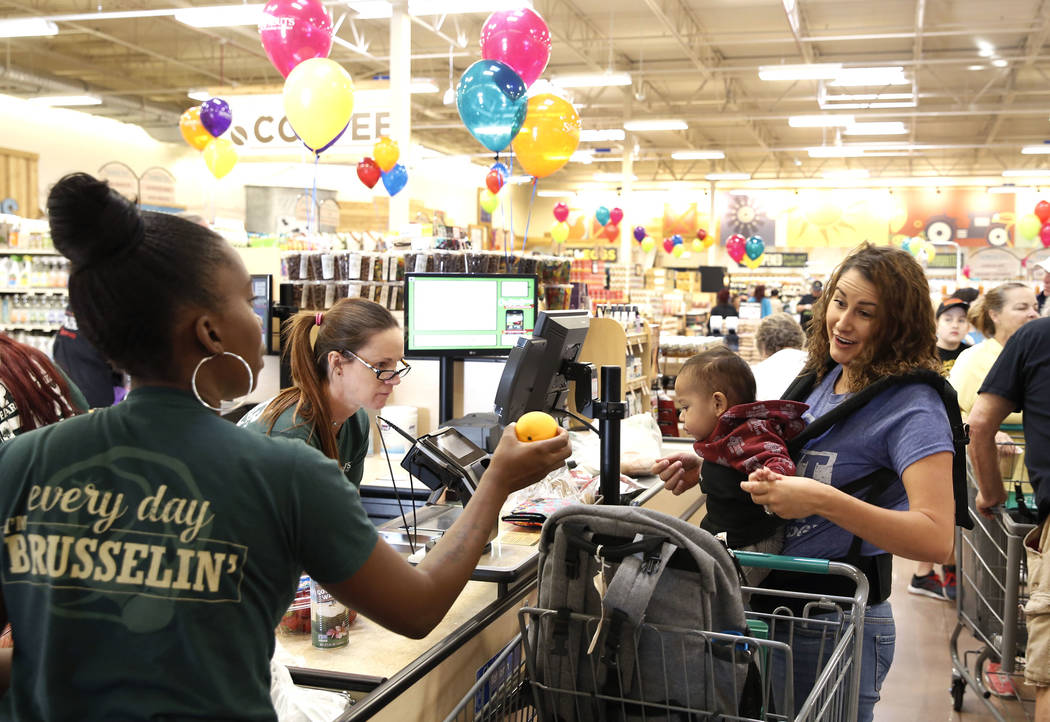 Sirena Pascual and her 1-year-old son Atlas check out during the opening day of Sprouts Farmers Market at 8441 Farm Road in Las Vegas on Wednesday Sept. 27, 2017. (Bizuayehu Tesfaye/Las Vegas Revi ...