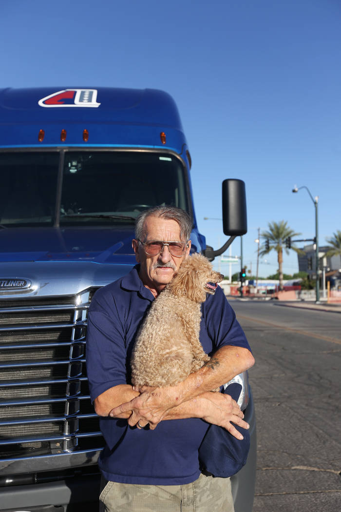 David Schember, the truck driver who carried the stone sculpture to be displayed in the healing garden, with his dog Brigitte Bardot at the Healing Garden in Las Vegas, Thursday, Sept. 20, 2018. R ...