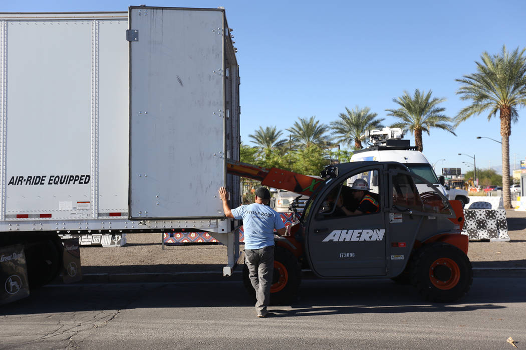 Workers transport the stone sculpture designed by artist Bobby Jacobs to the Healing Garden in Las Vegas, Thursday, Sept. 20, 2018. The back of the wings have the initials of each of the Oct. 1 vi ...