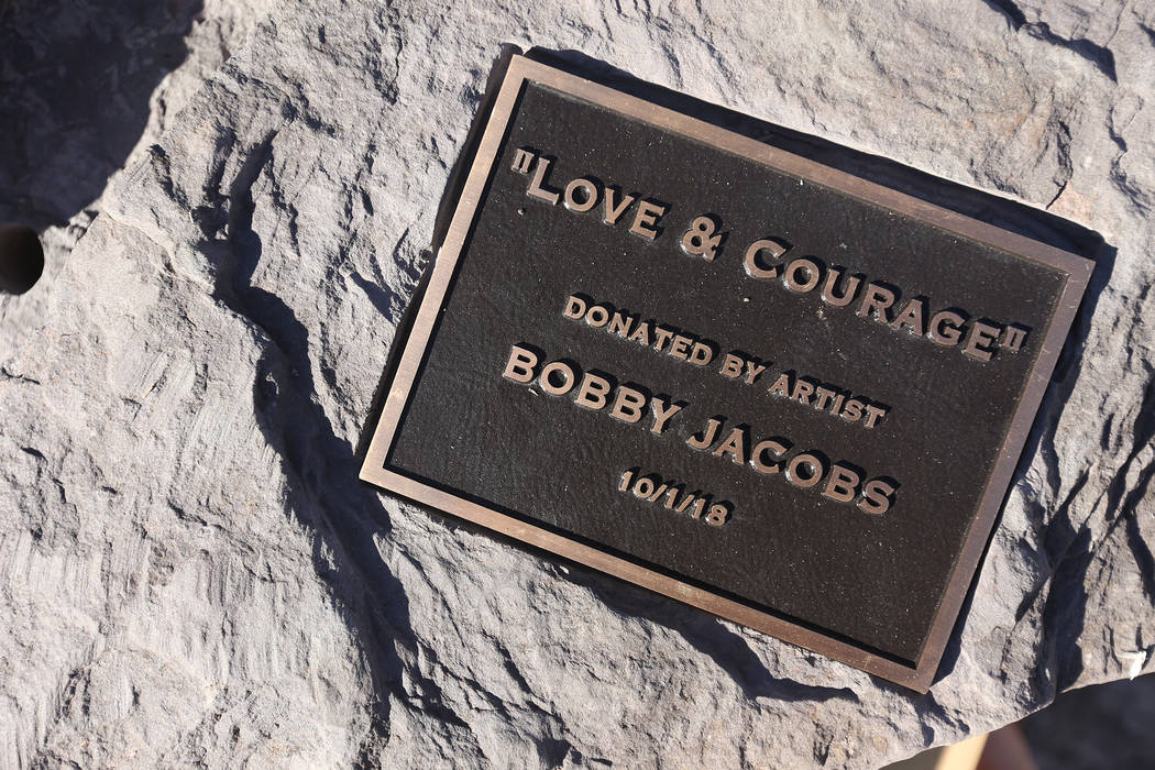 The base of the stone sculpture designed by artist Bobby Jacobs that will be placed in the Healing Garden in Las Vegas, Thursday, Sept. 20, 2018. The back of the wings have the initials of each of ...