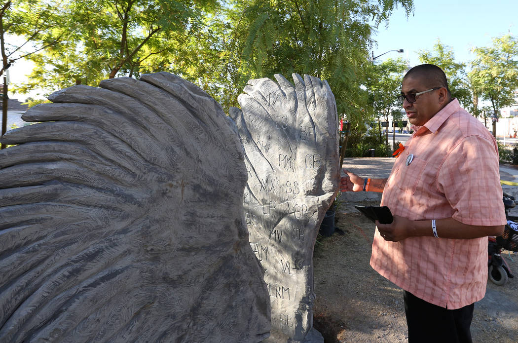 Daniel Rosales, a survivor of the Oct. 1 shooting, visits a sculpture of two separate angel wings on Friday, Sept. 21, 2018 at the Las Vegas Healing Garden. The two wings sculpture feature the ini ...