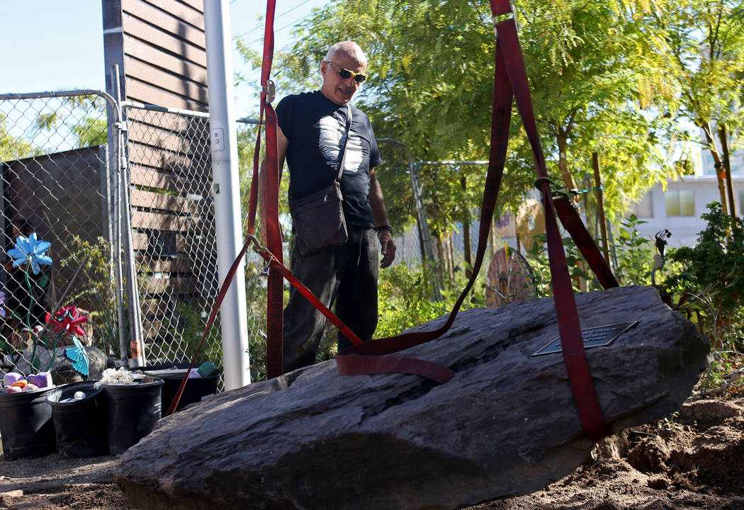 Artist Bobby Jacobs directs workers for the installation of a stone sculpture he created in the Healing Garden in Las Vegas, Thursday, Sept. 20, 2018. The back of the wings of the sculpture have t ...