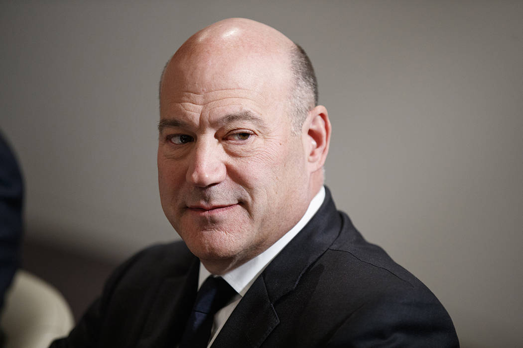 White House chief economic adviser Gary Cohn listens during a meeting between President Donald Trump and Israeli Prime Minister Benjamin Netanyahu at the World Economic Forum, Thursday, Jan. 25, 2 ...