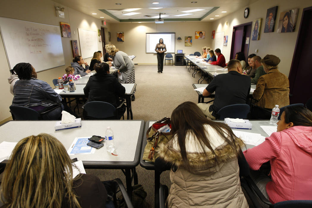 Family services specialist for Clark County Sha'Londa Adams speaks during an informational meeting on the process of becoming a foster parent Tuesday, Nov. 18, 2014, at Child Haven. (Sam Morris/La ...