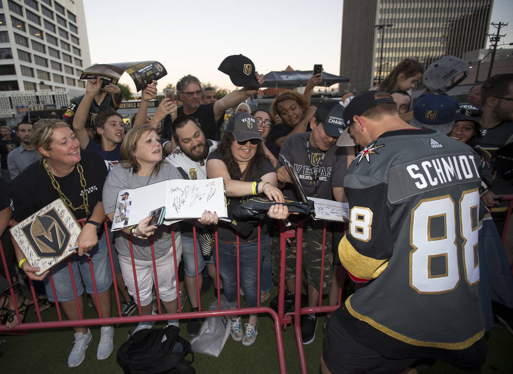 Vegas Golden Knights defenseman Nate Schmidt (88) signs autographs during a Vegas Golden Knights fan fest at the Downtown Las Vegas Events Center on Wednesday, Sept. 19, 2018. Richard Brian Las Ve ...