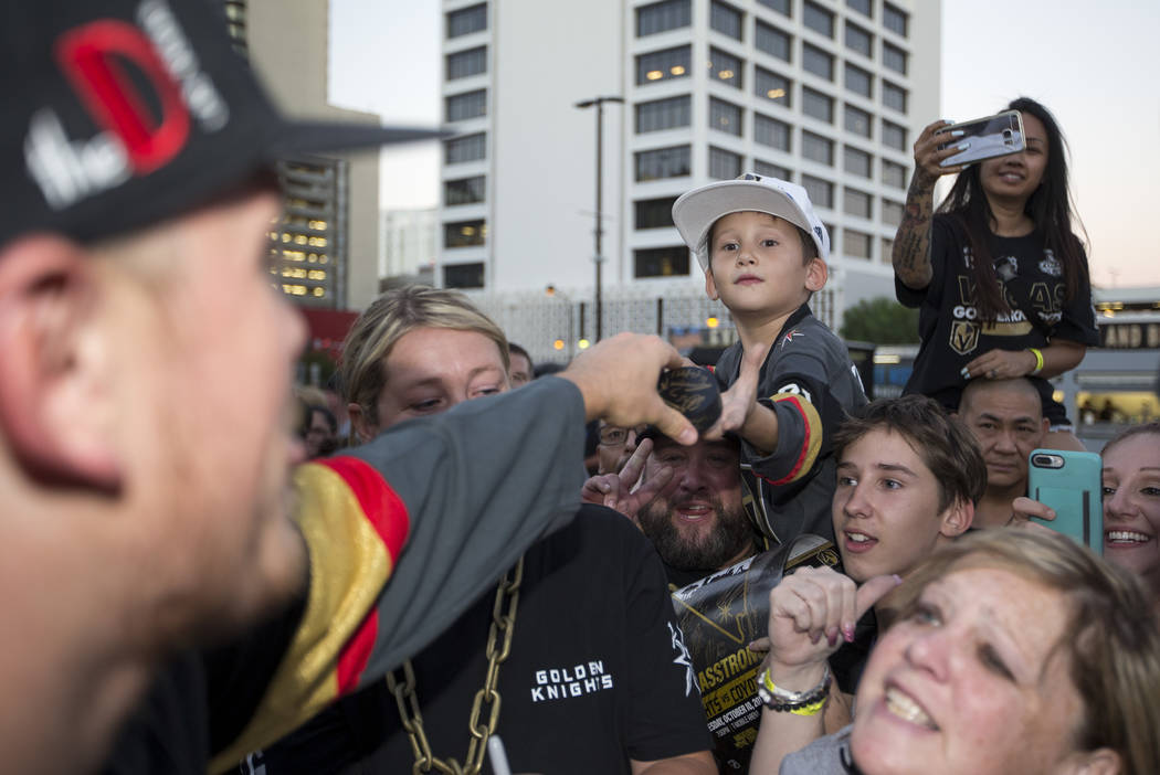 Jaxon Galvan, 6, gets his puck autographed by Vegas Golden Knights defenseman Nate Schmidt, left, during a Vegas Golden Knights fan fest at the Downtown Las Vegas Events Center on Wednesday, Sept. ...