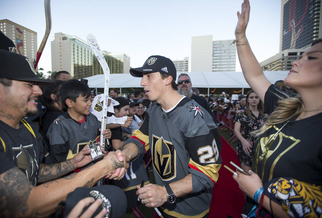 Vegas Golden Knights goaltender Marc-Andre Fleury (29), center, greets fans during a Vegas Golden Knights fan fest at the Downtown Las Vegas Events Center on Wednesday, Sept. 19, 2018. Richard Bri ...