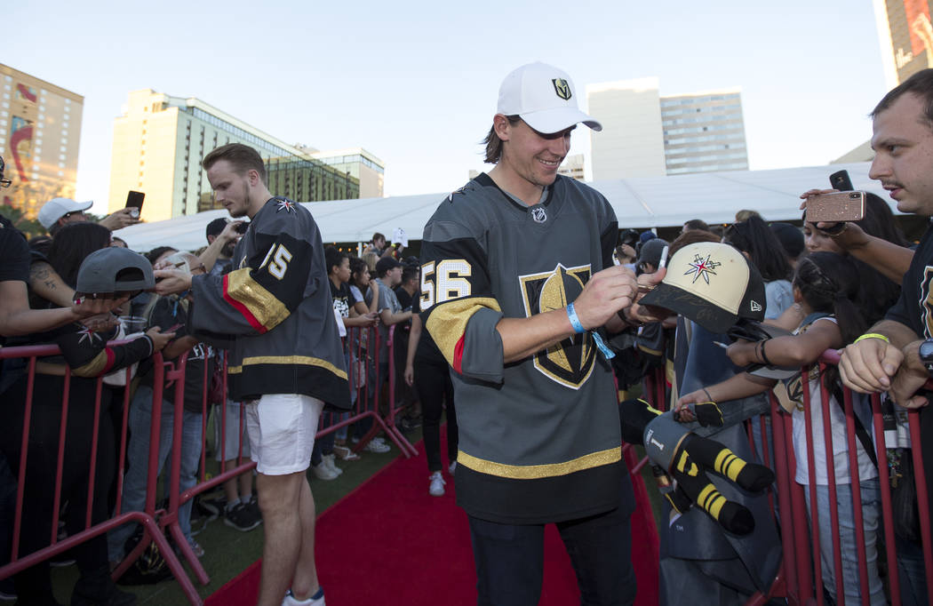 Vegas Golden Knights goaltender Oscar Dansk (35), left, and left wing Erik Haula (56) greets fans during a Vegas Golden Knights fan fest at the Downtown Las Vegas Events Center on Wednesday, Sept. ...