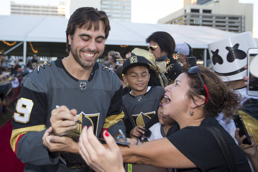 Vegas Golden Knights right wing Alex Tuch (89), left, signs autographs during a Vegas Golden Knights fan fest at the Downtown Las Vegas Events Center on Wednesday, Sept. 19, 2018. Richard Brian La ...