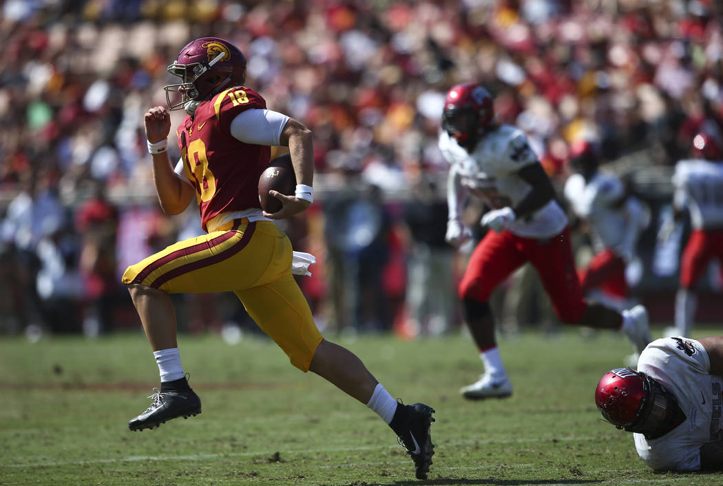 USC Trojans quarterback JT Daniels (18) runs the ball past the UNLV Rebels during the second half of a football game at the Los Angeles Memorial Coliseum in Los Angeles on Saturday, Sept. 1, 2018. ...