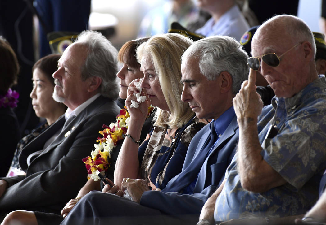 Robert Sanfilkippo, second right, sits next to his wife, Diana Brown Sanfilippo who has spent a lifetime searching for her father, 1st Lt. Frank Salazar who died 66 years ago in North Korea, who w ...