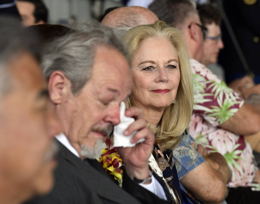 Diana Brown Sanfilippo right, who has spent a lifetime searching for her father, 1st Lt. Frank Salazar who died 66 years ago in North Korea, attends a ceremony marking the arrival of the remains b ...
