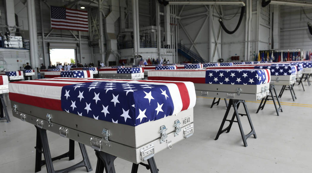 Transfer cases are placed in a hanger at a ceremony marking the arrival of the remains believed to be of American service members who fell in the Korean War at Joint Base Pearl Harbor-Hickam in Ha ...