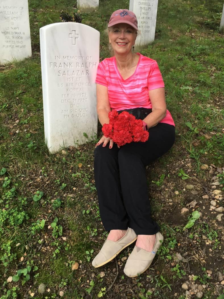 A photo of Diana Sanfilippo, 70, next to her father's tombstone at Arlington National Cemetery. Photo courtesy of Diana Sanfilippo.