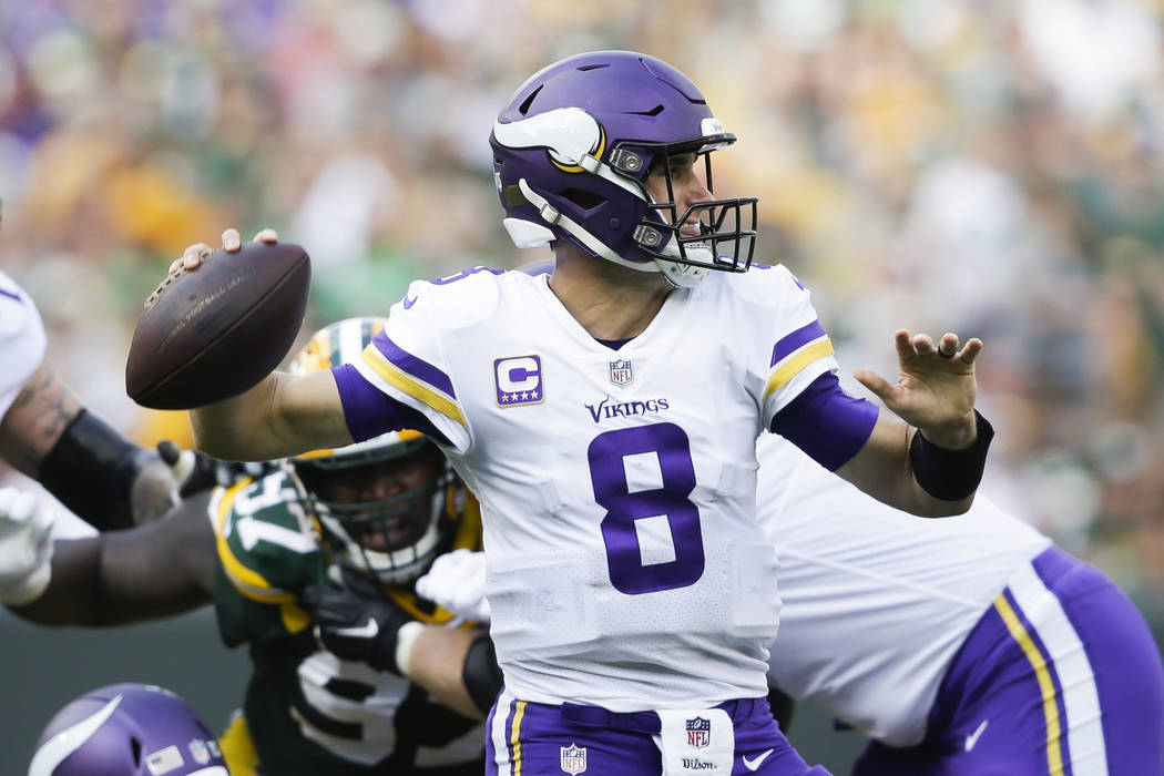 Minnesota Vikings' Kirk Cousins throws during the second half of an NFL football game against the Green Bay Packers Sunday, Sept. 16, 2018, in Green Bay, Wis. (AP Photo/Jeffrey Phelps)