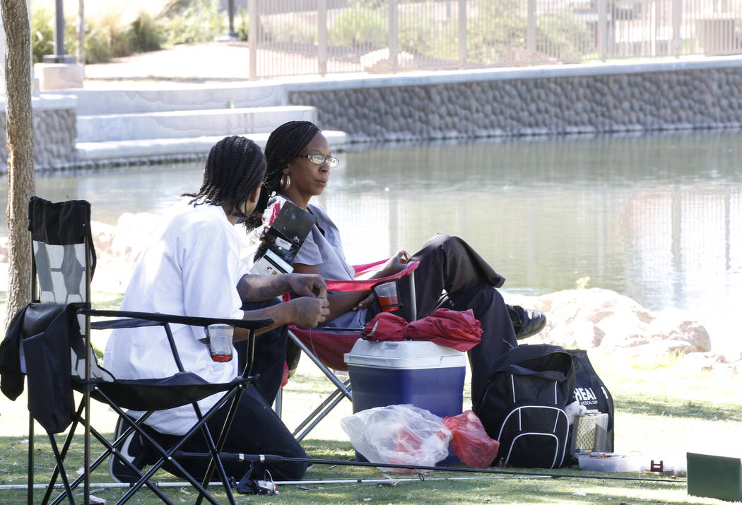 Darius Mitchell, left, and Casandra Johnson relax at Lorenzi Park on Wednesday, Sept. 19, 2018, in Las Vegas. (Bizuayehu Tesfaye/Las Vegas Review-Journal) @bizutesfaye