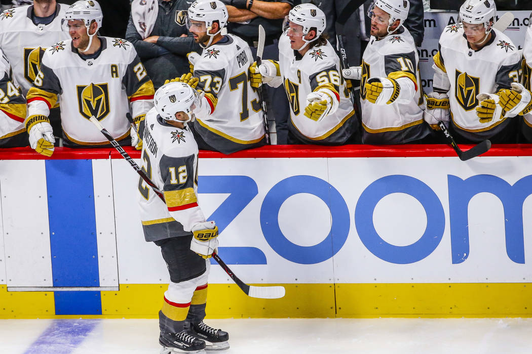 Vegas Golden Knights defenseman Erik Brannstrom (12) celebrates a goal with teammates on the bench during the second period of a preseason NHL hockey game between the Colorado Avalanche and the Ve ...