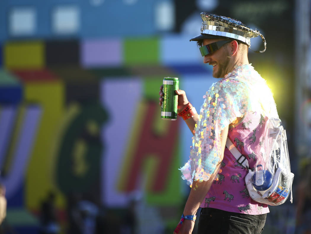 Matt Cantwell of Denver walks the festival grounds during the third day of the annual Life is Beautiful festival in downtown Las Vegas on Sunday, Sept. 23, 2018. Chase Stevens Las Vegas Review-Jou ...