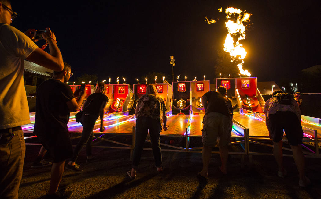 Attendees play flaming skee-ball during the third day of the annual Life is Beautiful festival in downtown Las Vegas on Sunday, Sept. 23, 2018. Chase Stevens Las Vegas Review-Journal @csstevensphoto