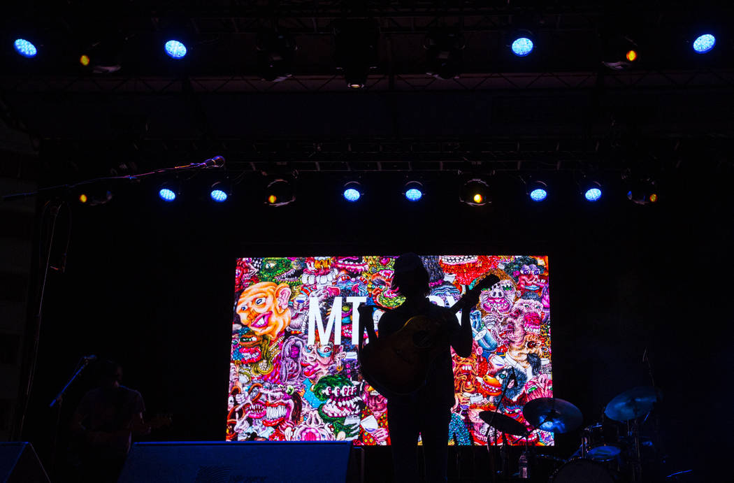 Matt Quinn of Mt. Joy is silhouetted while performing during the third day of the annual Life is Beautiful festival in downtown Las Vegas on Sunday, Sept. 23, 2018. Chase Stevens Las Vegas Review- ...