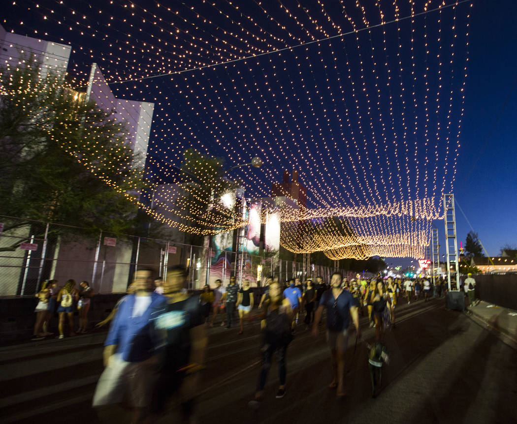 Attendees walk under a lighted canopy during the third day of the annual Life is Beautiful festival in downtown Las Vegas on Sunday, Sept. 23, 2018. Chase Stevens Las Vegas Review-Journal @cssteve ...