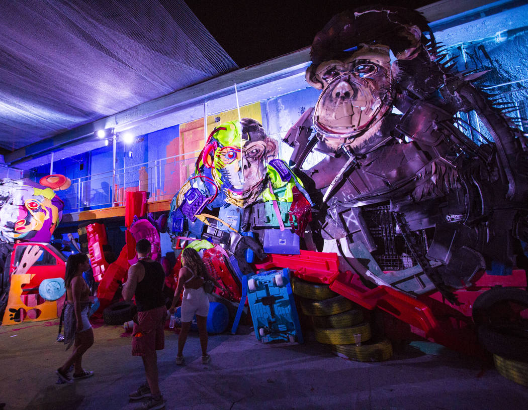 """Attendees explore the """"Wild Wild Waste"""" art installation by Bordalo II during the third day of the annual Life is Beautiful festival in downtown Las Vegas on Sunday, Sept. 23, 2018. Chas ..."""