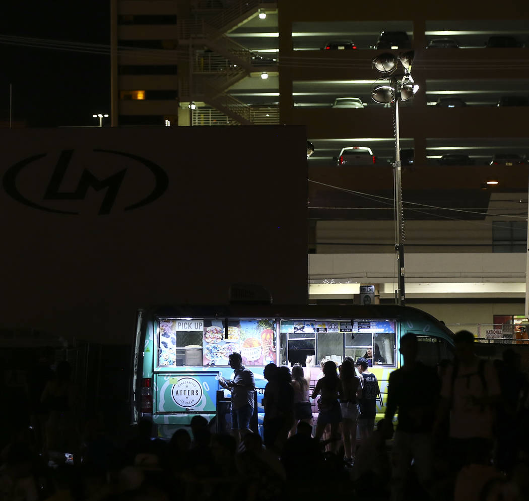 Attendees are silhouette while lining up for ice cream during the third day of the annual Life is Beautiful festival in downtown Las Vegas on Sunday, Sept. 23, 2018. Chase Stevens Las Vegas Review ...