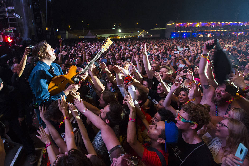 Win Butler of Arcade Fire gets up close with the crowd during the third day of the annual Life is Beautiful festival in downtown Las Vegas on Sunday, Sept. 23, 2018. Chase Stevens Las Vegas Review ...