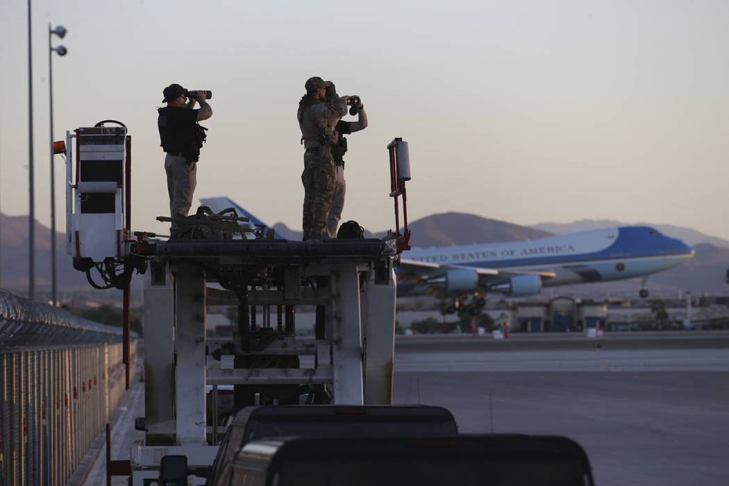 Security personnel look on as Air Force One with U.S. President Donald Trump lands at McCarran International Airport before on Thursday, Sept. 20, 2018. (Richard Brian/Las Vegas Review-Journal)