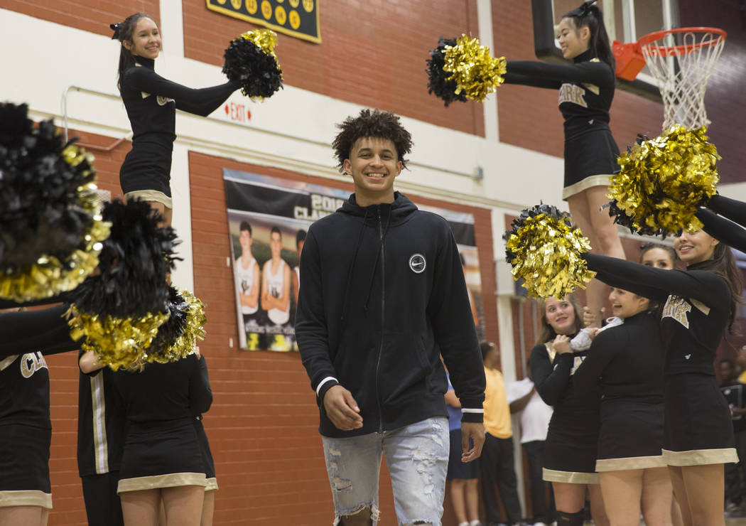 Clark senior Jalen Hill walks through a group of cheerleaders during an event to announce his commitment to play basketball at the University of Oklahoma on Thursday, Sept. 20, 2018, at Clark High ...