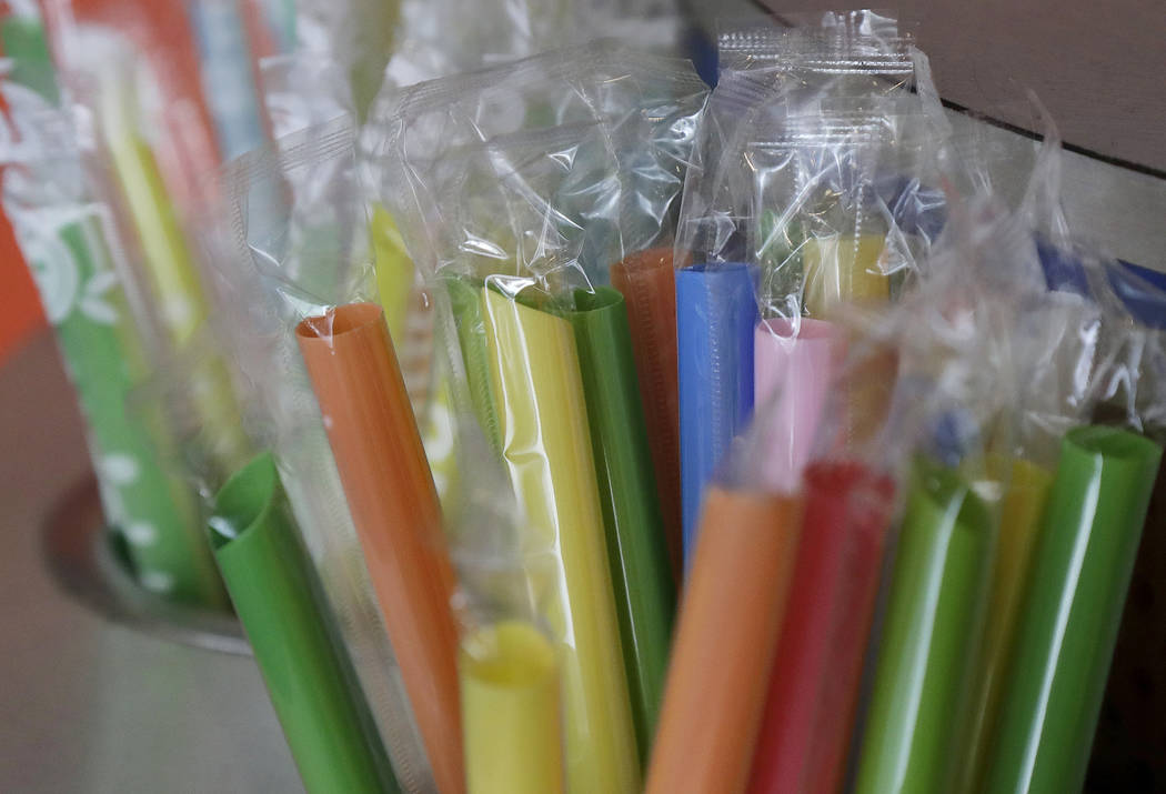 FILE - This July 17, 2018 file photo shows wrapped plastic straws at a bubble tea cafe in San Francisco. A law signed Thursday, Sept. 20, 2018, by Gov. Jerry Brown makes California the first state ...