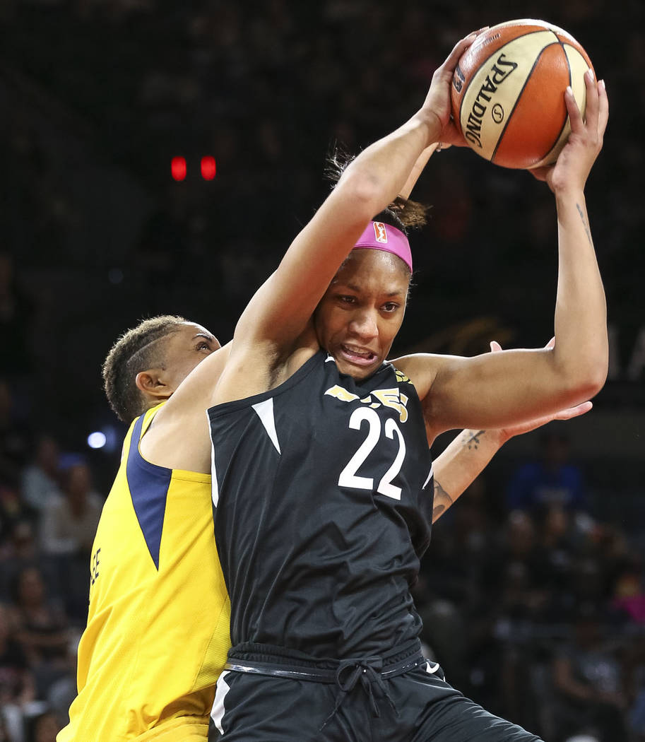 Las Vegas Aces center A'ja Wilson (22) pulls in the rebound over Indiana Fever forward Candice Dupree (4) during the first half of a WNBA basketball game at the Mandalay Bay Events Center on Satur ...