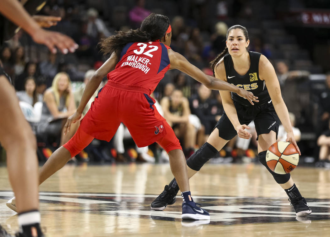 Las Vegas Aces guard Kelsey Plum (10) dribbles the ball as Washington Mystics guard Shatori Walker-Kimbrough (32) defends in the second half of a WNBA basketball game at the Mandalay Bay Events Ce ...