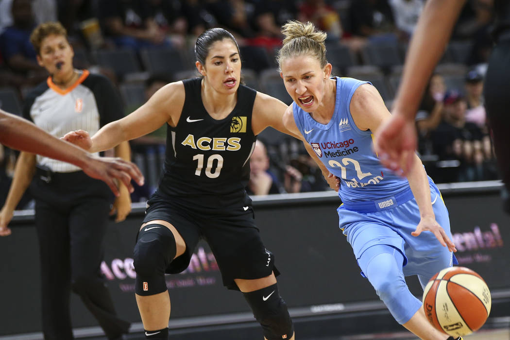 Chicago Sky guard Courtney Vandersloot (22) drives the ball past Las Vegas Aces guard Kelsey Plum (10) during the first half of a WNBA basketball game at Mandalay Bay Events Center in Las Vegas on ...