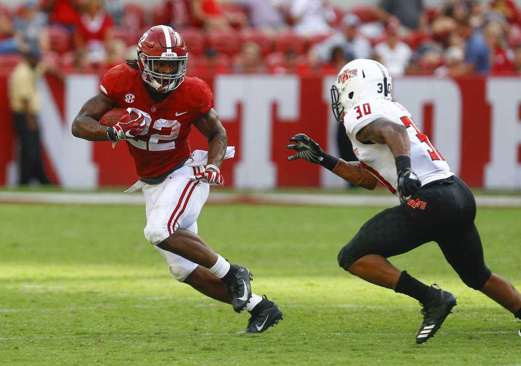 Arkansas State defensive back Derrick Bean (30) tries to stop Alabama running back Najee Harris (22) as he carries the ball during the second half of an NCAA college football game, Saturday, Sept. ...