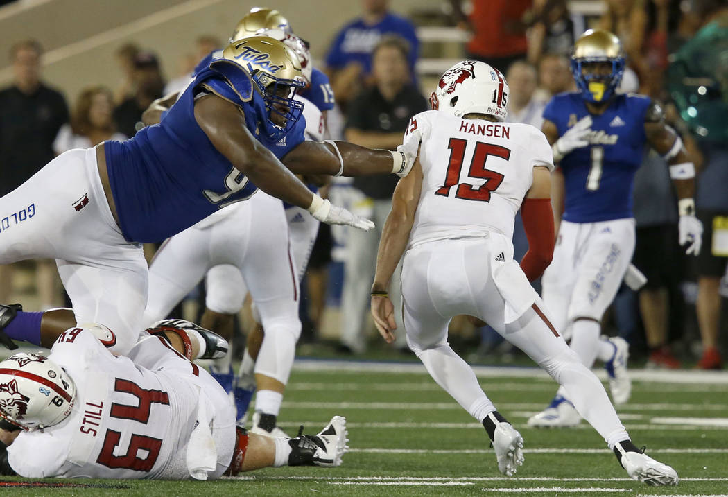 Tulsa's Tyarise Stevenson goes after Arkansas State's quarterback Justice Hansen during an NCAA college football game, Saturday, Sept. 15, 2018 in Tulsa, Okla. (Stephen Pingry/Tulsa World via AP)