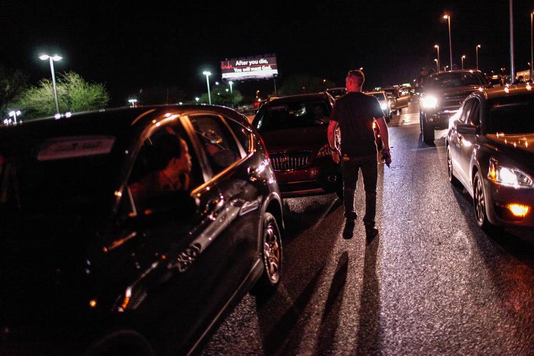 A police officer directs vehicles in traffic on Interstate 15 in Las Vegas after a shooting on Sunday, Oct. 1, 2017. Joel Angel Juarez Las Vegas Review-Journal @jajuarezphoto