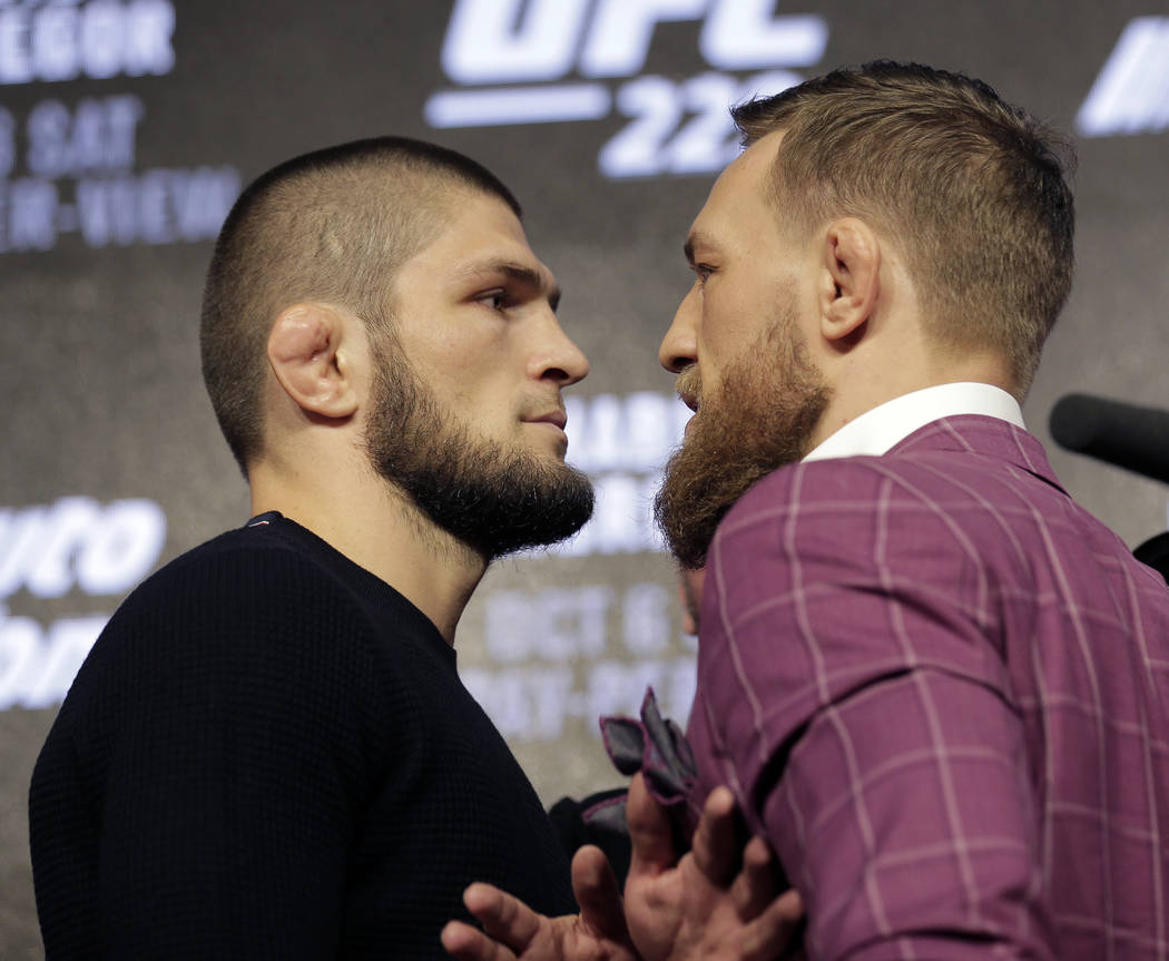 Conor McGregor, right, and Khabib Nurmagomedov pose for pictures during a news conference in New York, Thursday, Sept. 20, 2018. McGregor is returning to UFC after a two-year absence. He fights un ...