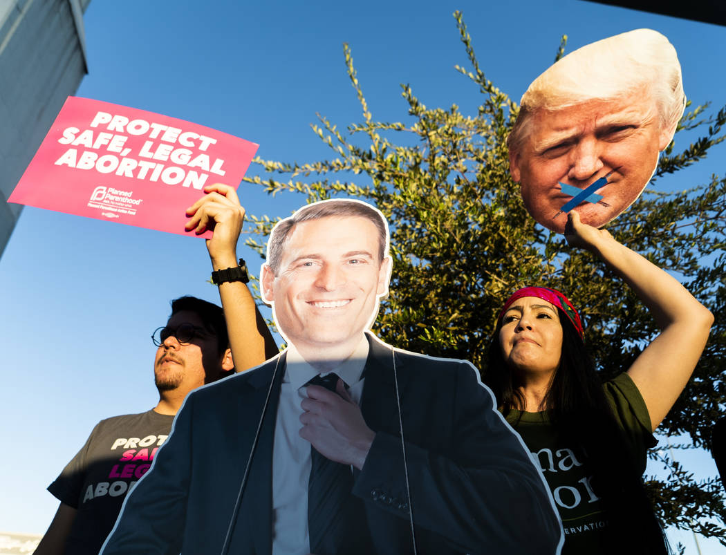 Alex Camberos, left, and Barbara Hartzell protest against Trump in front of the Las Vegas Convention Center in Las Vegas, Thursday, Sept. 20, 2018. (Marcus Villagran/Las Vegas Review-Journal) @mar ...